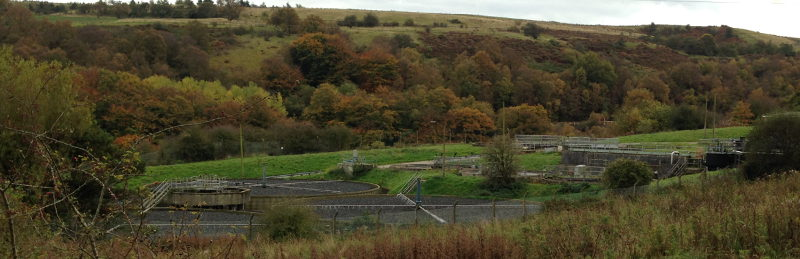 Brynmawr sewage works, rebuilt following the rock fall. The grass behind the filter beds marks the edge of the gorge, with the A465 immediately below. Click to enlarge