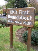 A sign for the UK's first roundabout