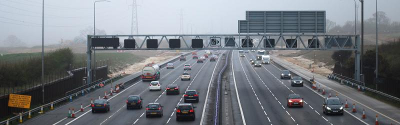 The M25's new junction takes shape through the April drizzle. Even the people who will be allowed to use it aren't allowed to use it yet. Click to enlarge