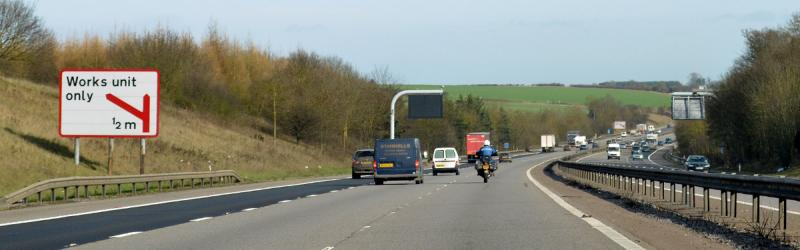 A strangely coloured sign on the M4, and another in the distance. What works happen here? Click to enlarge