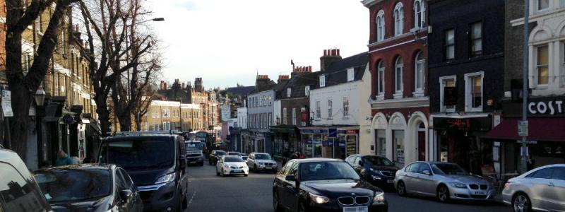 Blackheath village, with its jumble of Victorian buildings and narrow, twisting streets, remains picturesque despite the traffic. Most of the buildings on the right and all those in the distance would have been lost to the South Cross Route. Click to enlarge