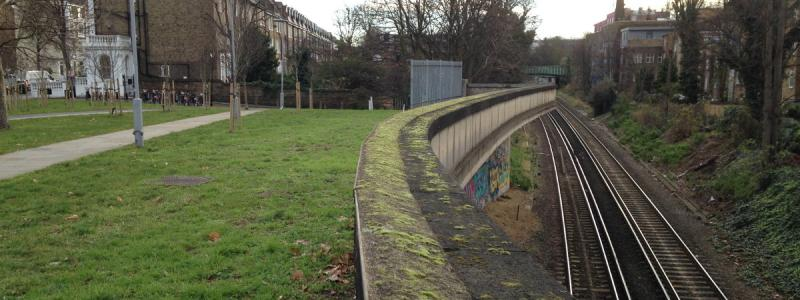 A stub of the unbuilt northbound off-slip to Holland Park Roundabout still hangs over the railway. Click to enlarge