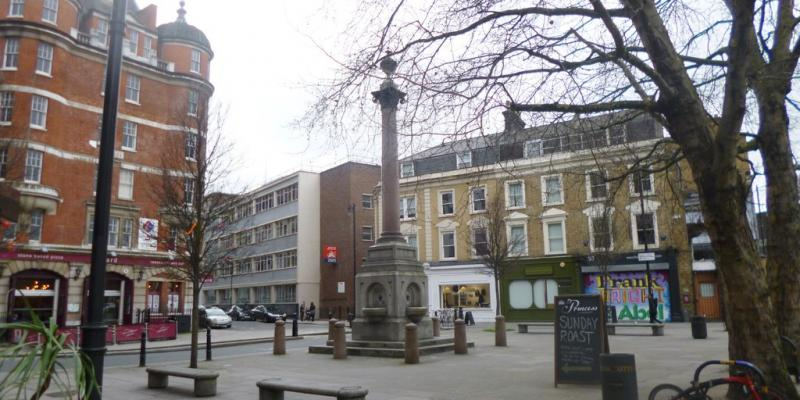 A drinking fountain and pedestrian plaza at the north end of Tabernacle Street and Paul Street. They will be Ultra Low Emission streets, but immediately behind the camera is the Inner Ring Road carrying more than 30,000 vehicles each day. Click to enlarge