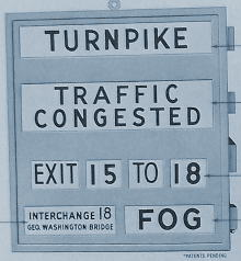 Rotating panel sign for use in the US. Click to enlarge