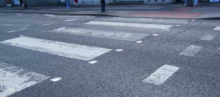 Striped road markings on a Zebra Crossing