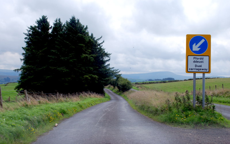 "At the top of the hill, the ""keep left"" sign marks the start of the dual carriageway."