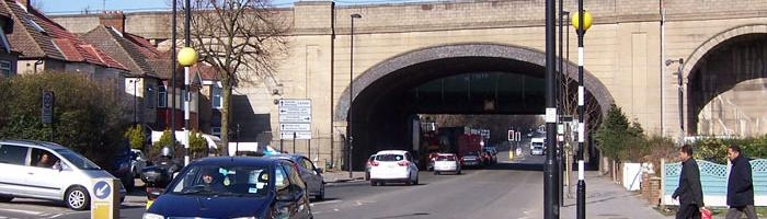 The arched Central Line viaduct, with extra-wide span to cross Greenford Road. Click to enlarge