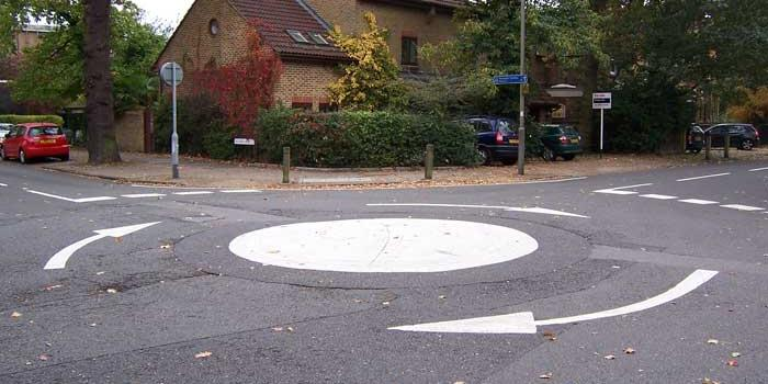 A mini roundabout, more often driven over than around. Click to enlarge