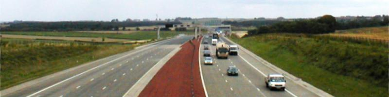 The M1 near Leeds in 2001, just two years after opening, with a tarmac overlay visible in the distance. Click to enlarge