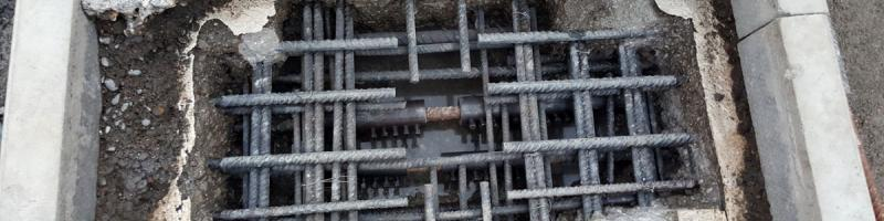 Repairs to corroded rebar in progress, with new segments spliced in. Click to enlarge