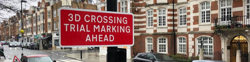 "A red sign reads ""3D crossing trial marking ahead"", which rather spoils the element of surprise. Click to enlarge"