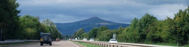 Sugar Loaf dominates the view ahead on the long, straight approach to Abergavenny. Click to enlarge