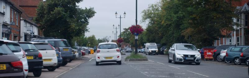 Through the centre of Beaconsfield, the town's main shopping street is no longer a major arterial road but it's still dominated by cars. Click to enlarge