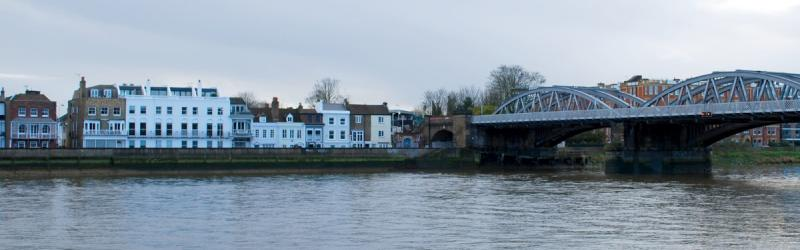 The serene riverfront at Barnes Bridge. Ringway 2 would have crossed the river in front of the railway bridge and destroyed half the historic terrace. Click to enlarge