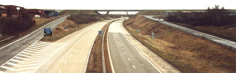 "Swanley Interchange in 1985, shortly before the ""bridge to nowhere"" in the distance finally opened to traffic. Click to enlarge"