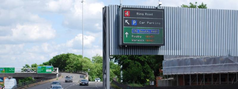 An advance sign for junction 4, complete with a green primary route panel and blue motorway patch. Click to enlarge