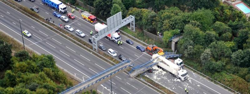 The scene of the bridge collapse, taken from a police helicopter shortly after emergency services arrived. Courtesy NPAS Redhill. Click to enlarge