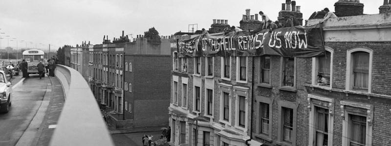 "Residents of Acklam Road protest at the opening of the Westway with a banner reading ""get us out of this hell, rehouse us now"". Click to enlarge"