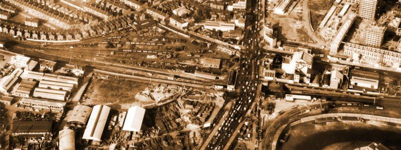 Traffic congestion on the A13 at Silvertown in the early 1960s, where the current Canning Town Flyover stands. A line has been cleared for the straightening of the route to the top right. Click to enlarge.