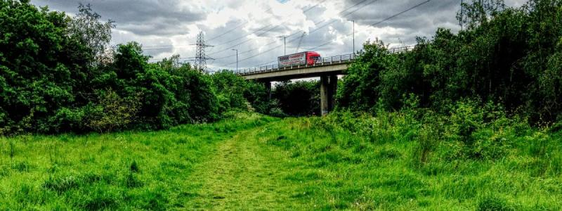 "The M11 looms over Roding Valley Park, road design in otherwise pleasant open space that the Layfield Report described as an ""environmental disaster"". Click to enlarge"