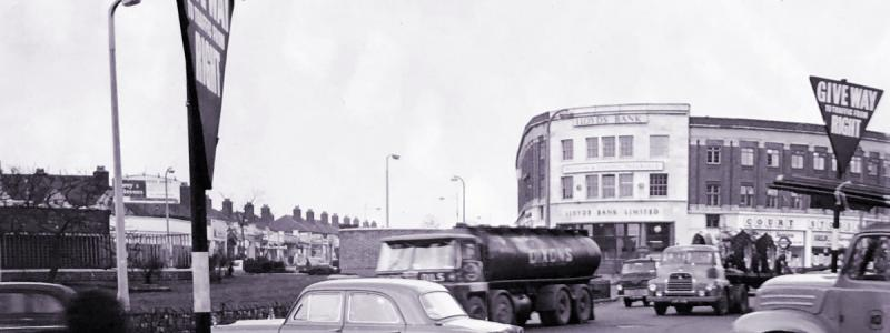 Gants Hill Roundabout on Eastern Avenue, 1964: a nearly-new trunk road that had become a shopping centre. Click to enlarge