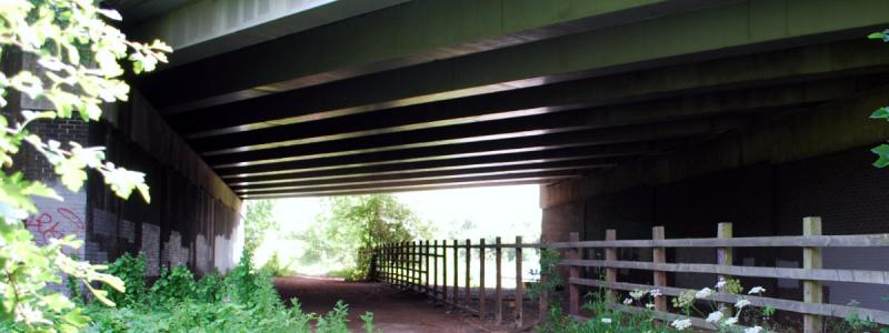 A spare bridge span, wide enough for a two-lane sliproad with hard shoulder, below the A41. The M1 is to the right. Click to enlarge