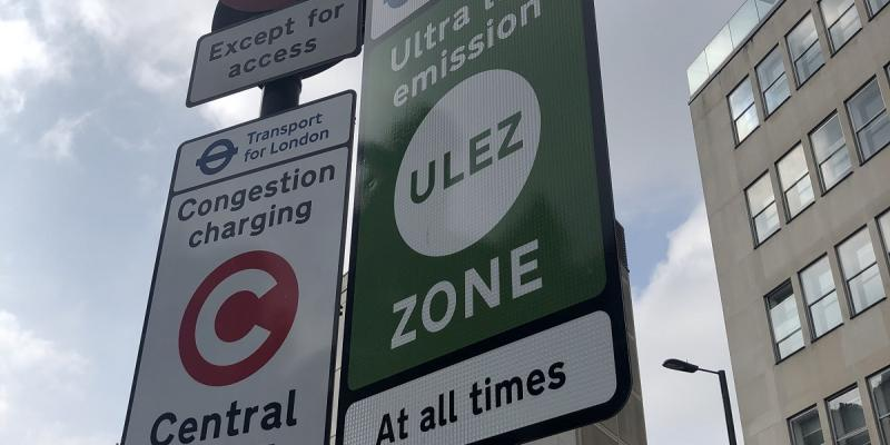 A new sign for the ULEZ, next to an existing Congestion Charge sign. Click to enlarge