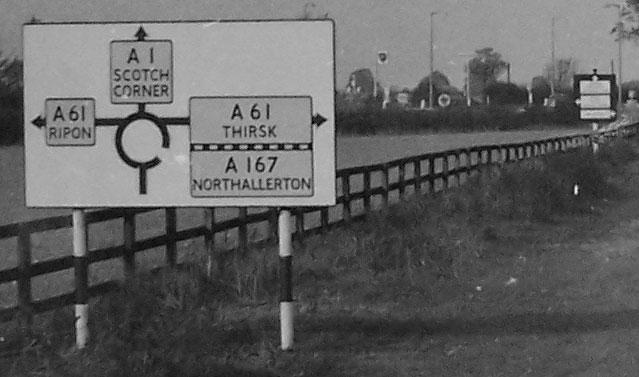A sign on the A1 conforming to 1950s road sign regulations. Click to enlarge