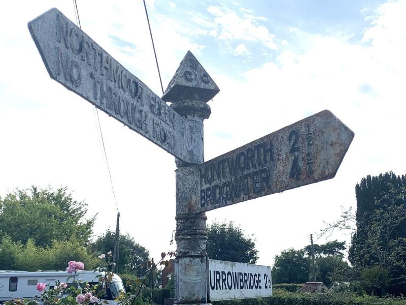 While walking across Somerset, especially (and obviously) upon roads, these fingerposts are wonderful sights to see. Not only do they help you get your bearing but they also allow you to work out how far you've come and how far you have left to travel. This one could do with some restoration but is still doing its job.