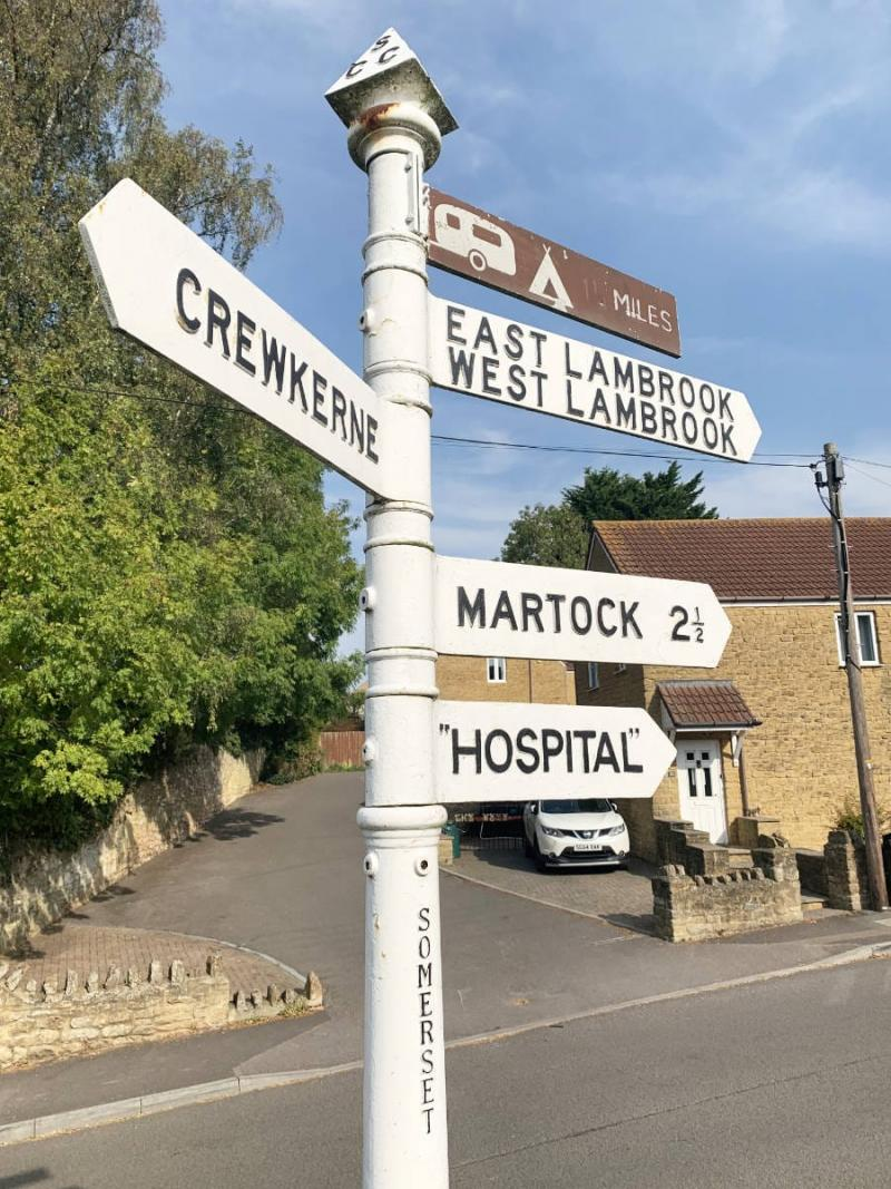 "South Petherton is located not far from Ilminster and its infamous A303 Ilminster Bypass, but here in the housing estates, this sign stands in wonderful tranquility. The quotes around ""Hospital"" are slightly concerning though - what exactly is going on in that building?"