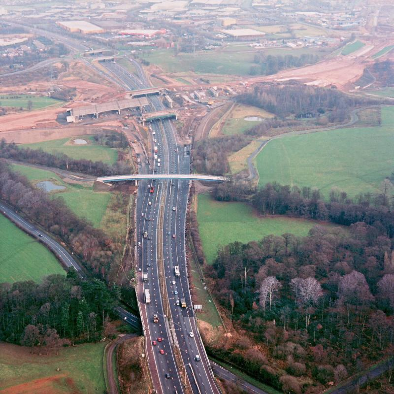 M6 interchange and Cuerden footbridge, view north